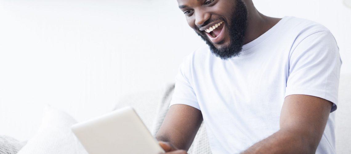 image of a sport fan watching on ipad