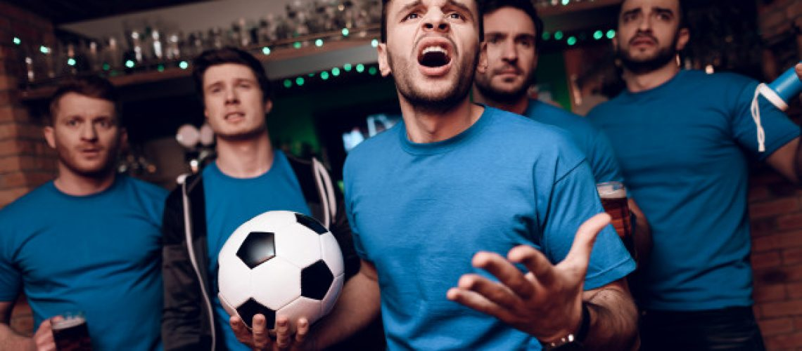 five-soccer-fans-sad-that-their-team-looses-bar_99043-1898