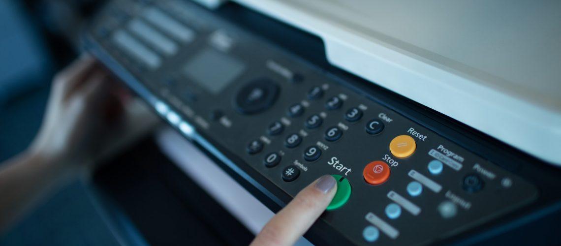 Hand on businesswoman using copy machine